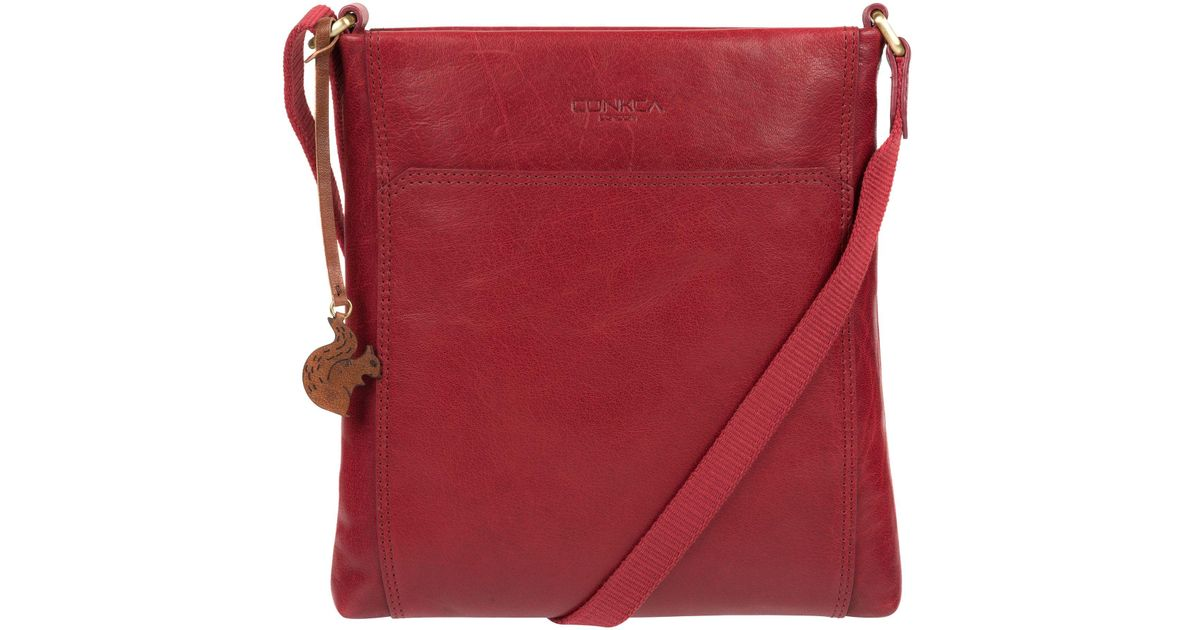 b6bf48539e2b Conkca London Chilli Pepper  dink  Handcrafted Leather Cross-body Bag in  Red - Lyst