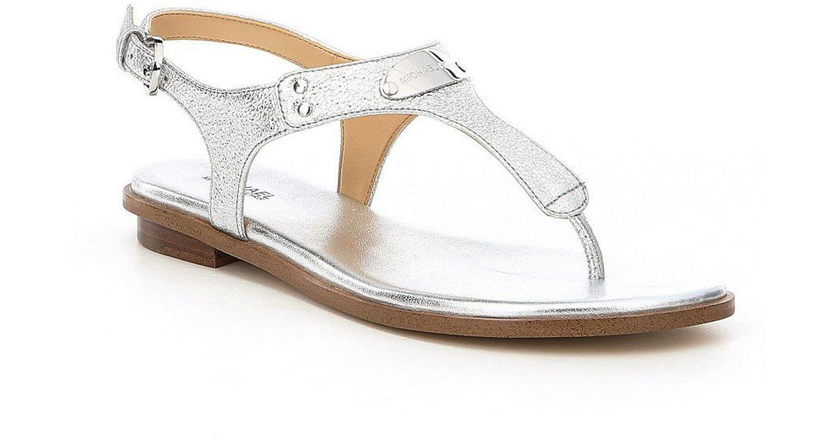 2c473ce149ef Lyst - MICHAEL Michael Kors Mk Sparkle Metallic Leather Plate Thong Sandals  in Metallic