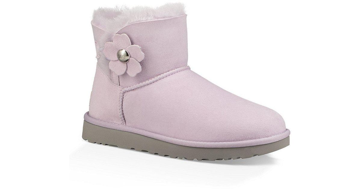 2fdf994169291 Lyst - UGG Mini Bailey Button Poppy Flower Ornament Booties in Blue