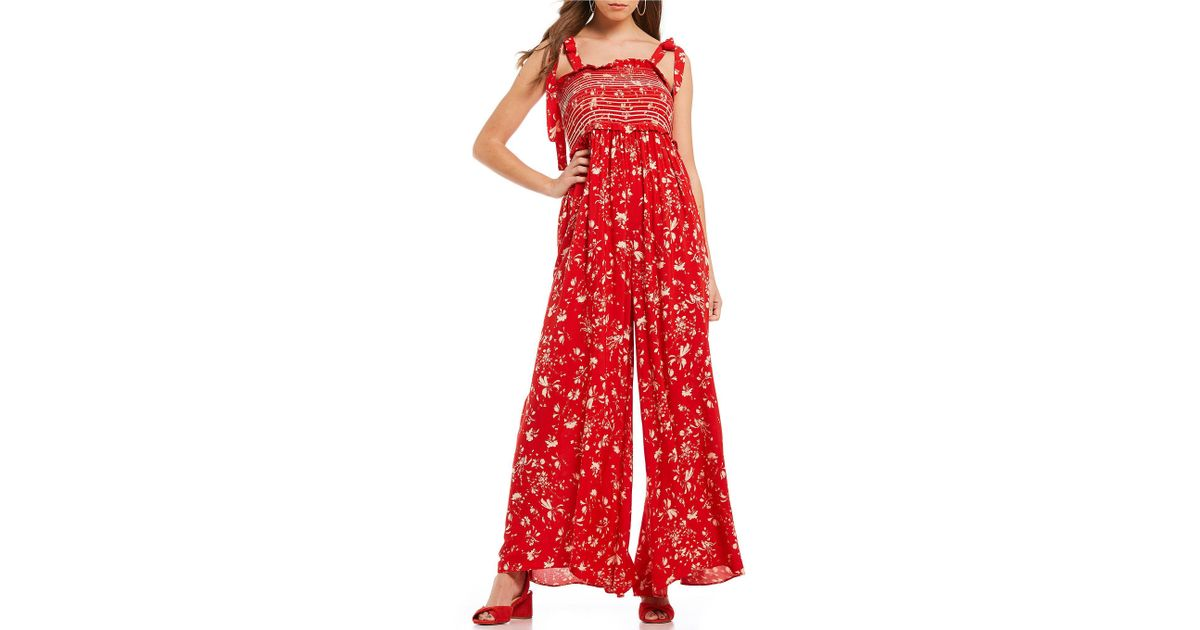 e605b7f5edcc Lyst - Free People Color My World Smocked Ditsy Floral Print Prairie Wide  Leg Jumpsuit in Red