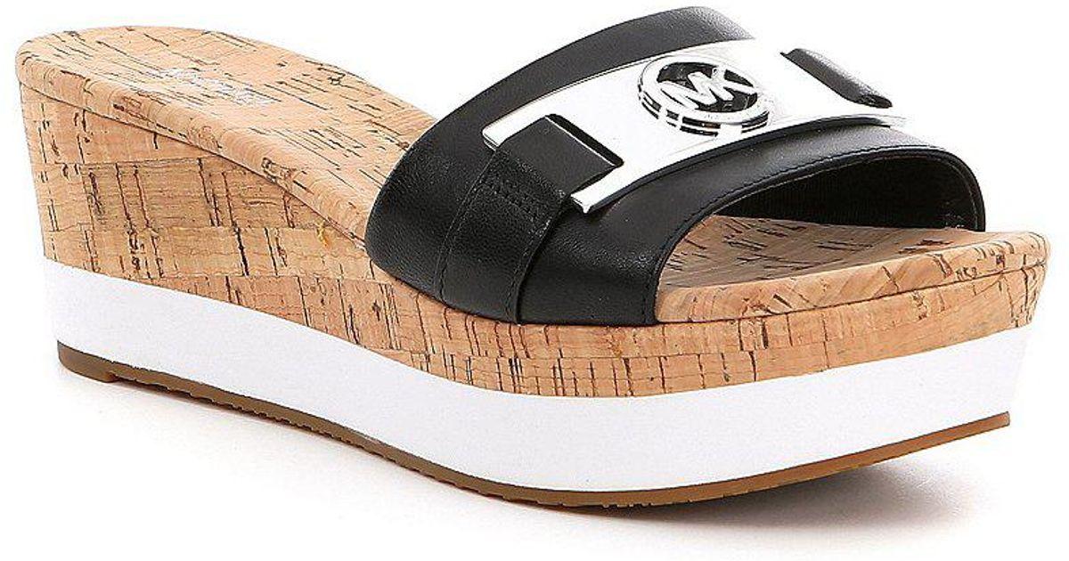 069ec3ec90 MICHAEL Michael Kors Warren Platform Wedge Sandals in Black - Lyst