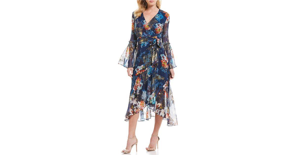 1437582f0ff Nicole Miller Floral Print Bell Sleeve Ruffle Hem Wrap Style Midi Dress in  Blue - Lyst