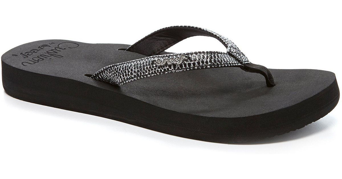 0692aed8573a Lyst - Reef Star Cushion Sassy Flip Flop in Black