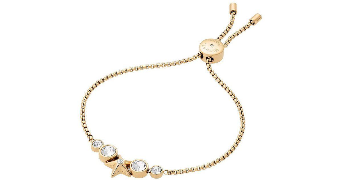 02b0ce5e379a Lyst - Michael Kors Beyond Brilliant Celestial Star Slider Bracelet in  Metallic