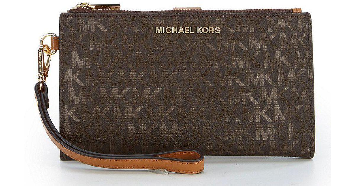 28e8454b46190 Lyst - MICHAEL Michael Kors Signature Adele Double-zip Wristlet