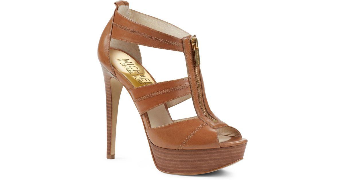 278e25a5b168 Lyst - Michael Kors Berkley Tstrap Sandal in Brown