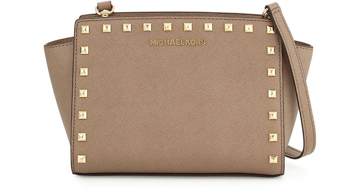 4bb97abdb5 ... new zealand lyst michael michael kors selma medium studded messenger bag  in natural 57fb4 30b28