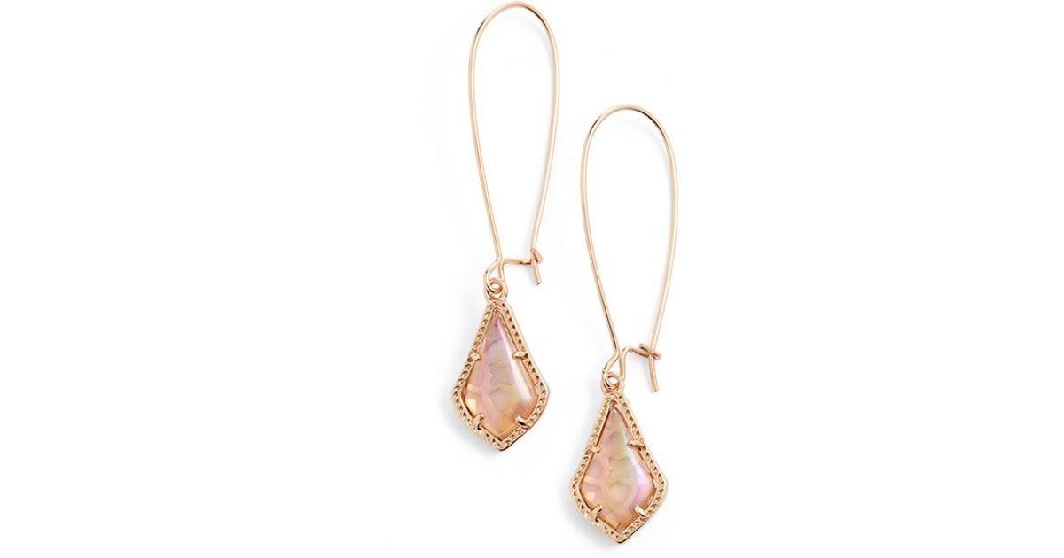 plated us gold stud peach claire s earrings