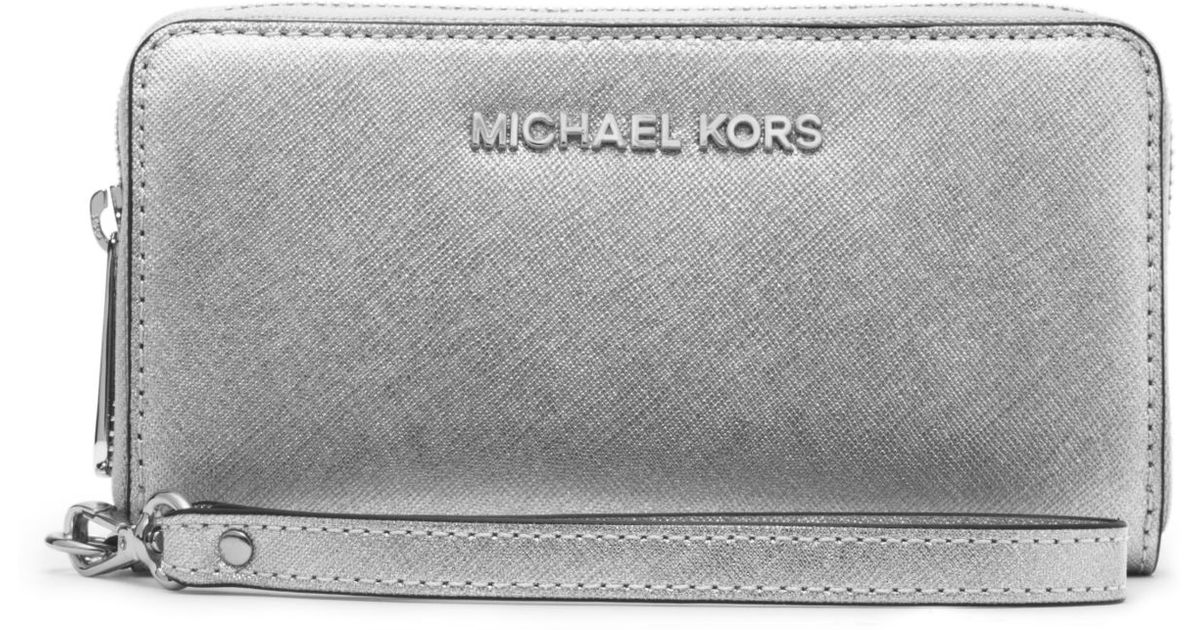 e4c4fe9bffbf Lyst - Michael Kors Jet Set Travel Large Metallic Leather Smartphone  Wristlet in Metallic