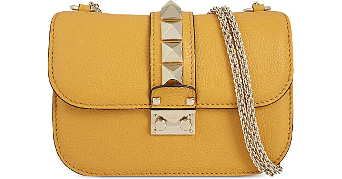 9f2cf820cf Valentino Small Rockstud Shoulder Bag in Yellow - Lyst