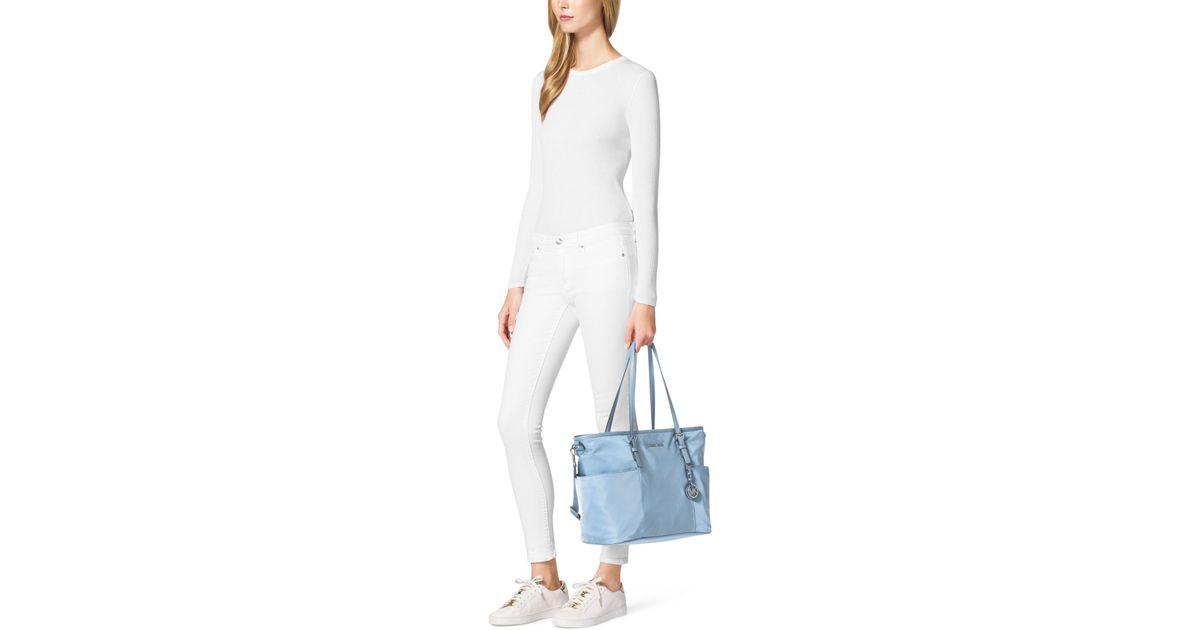 5a3878f606c321 Michael Kors Jet Set Large Nylon Diaper Bag in Blue - Lyst