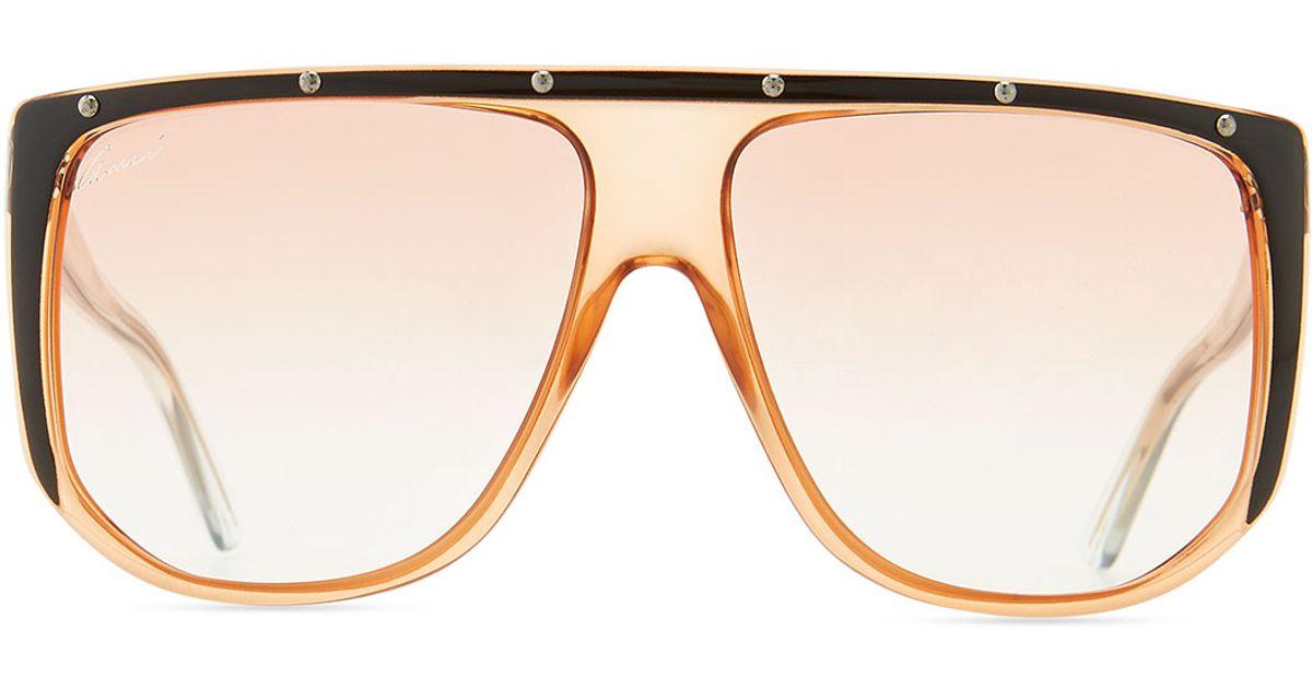 a91995f8119 Lyst - Gucci Studded Plastic Shield Sunglasses in Orange