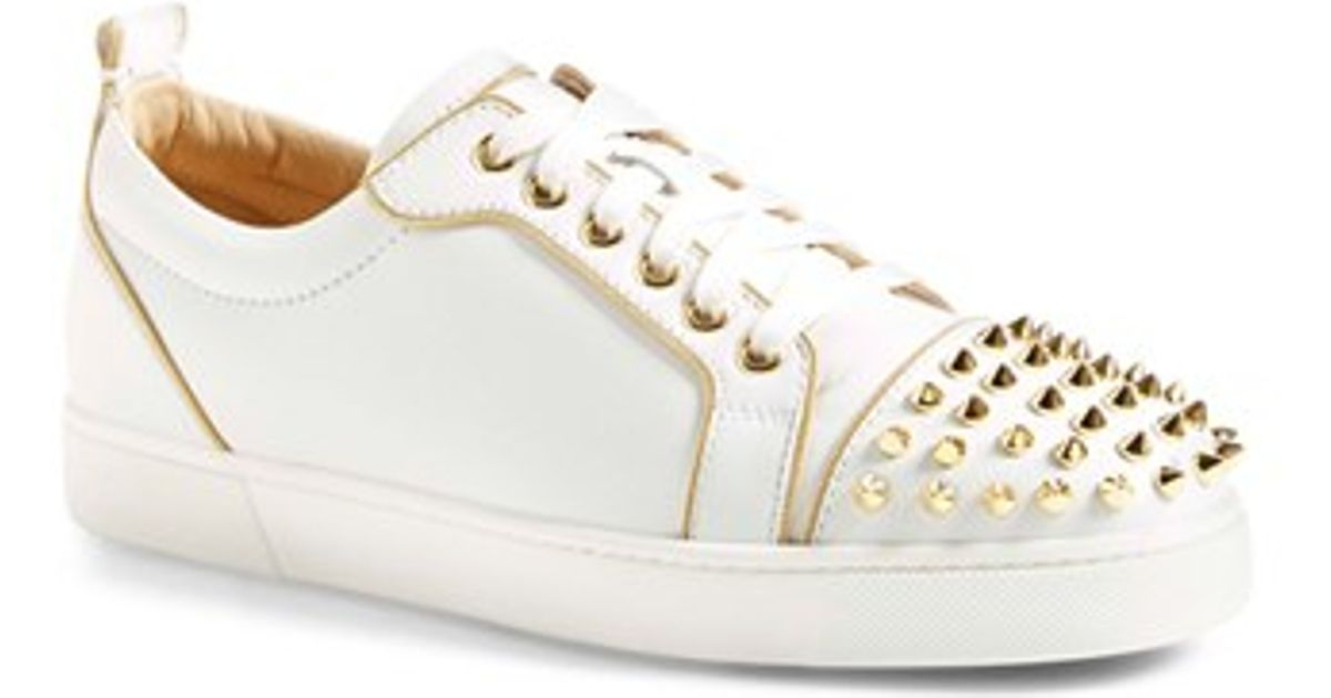 0a19bb7ec1fc ... top sneaker white gold 4bffc 52909  czech lyst christian louboutin rush studded  sneaker in metallic 33c16 58011