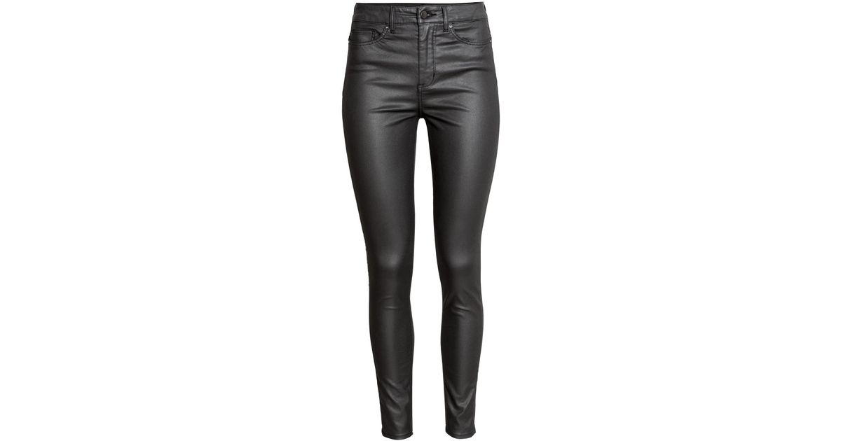 587010c18f0a2 H&M Super Skinny High Coated Jeans in Black - Lyst