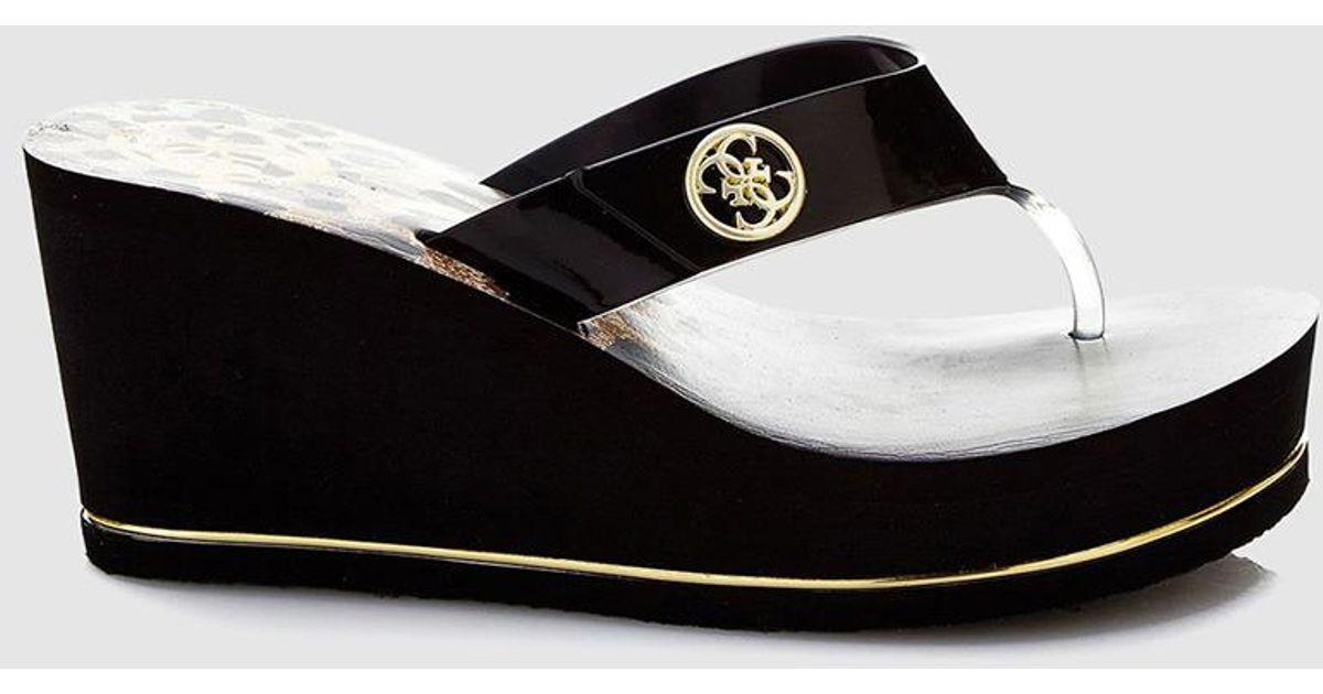 c7b8acc0067 Lyst - Guess Black Wedge Flip-flop Sandals in Black