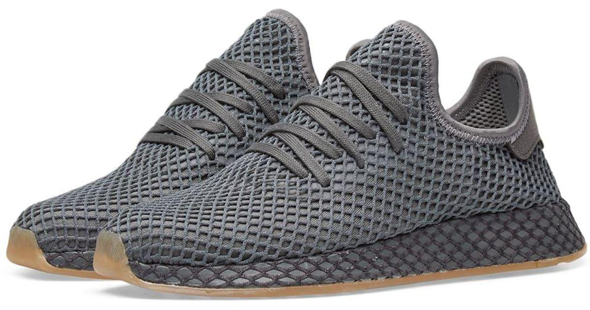 lyst adidas deerupt runner in grigio per gli uomini.