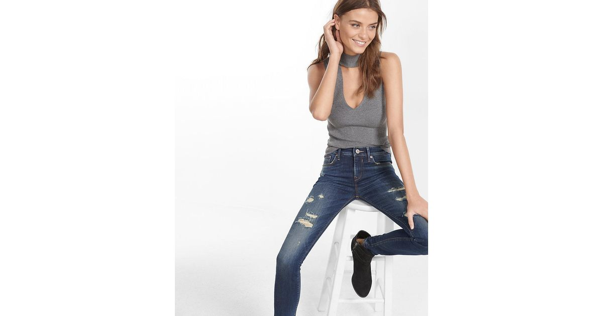 Lyst express petite mid rise distressed jean legging in blue for Express wash roma