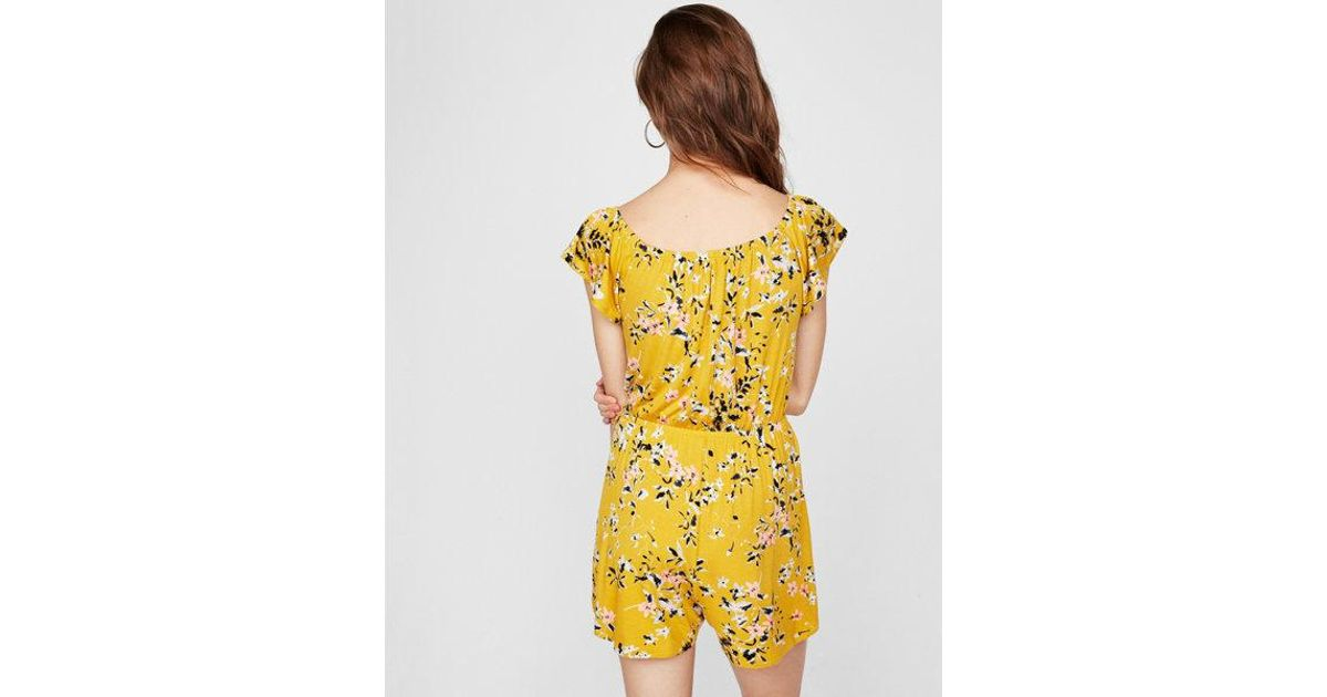454a9a9e1c7 Express Floral Wrap Front Romper in Yellow - Lyst