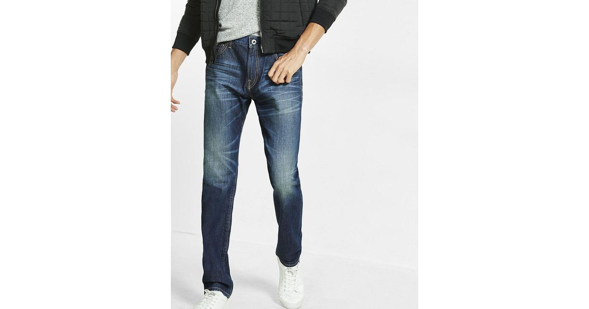 Lyst express tapered leg loose fit dark wash jean in for Express wash roma
