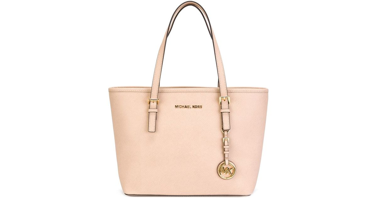 7a222d56d063 ... order lyst michael michael kors small jet set travel tote in natural  a860e 913ce