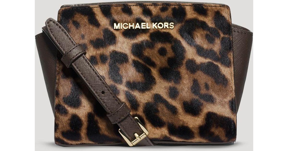 ec0e56ac1b46 Lyst - MICHAEL Michael Kors Crossbody - Haircalf Selma Mini Messenger in  Brown