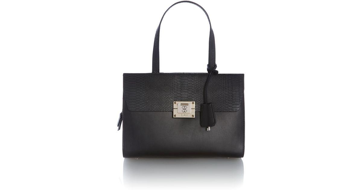15b6cc0303ad Lyst - Guess Black Flapover Shoulder Bag in Black