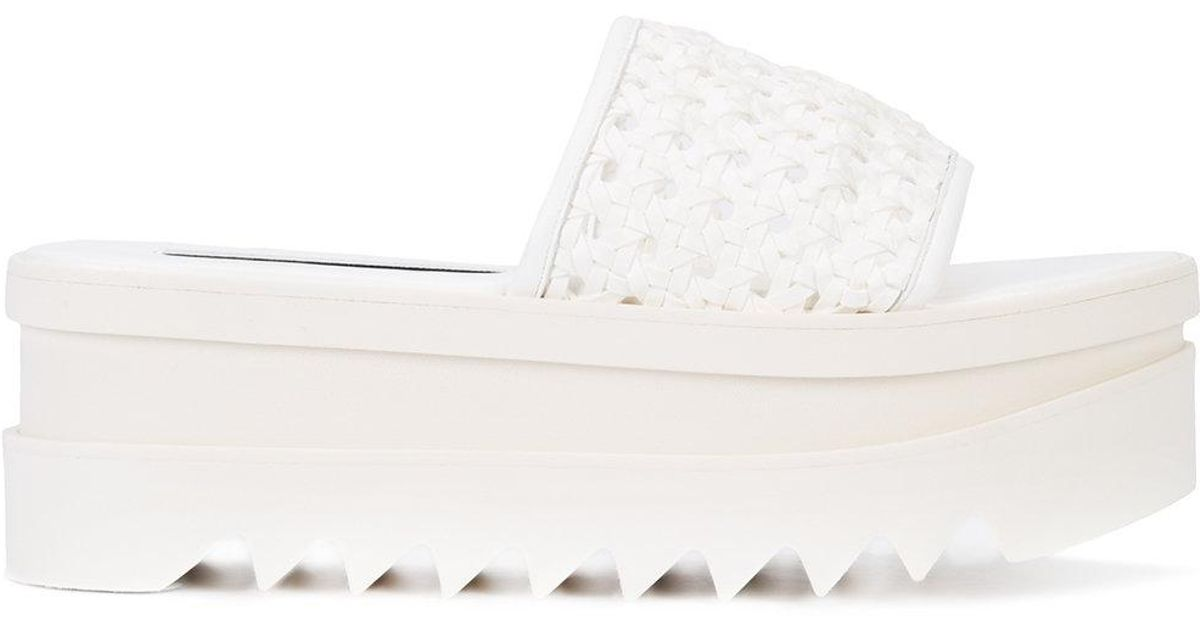 071302f3aaa Lyst - Stella McCartney Platform Perforated Pool Slide Sandal in White
