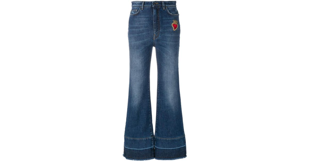 Lyst dolce gabbana flared jeans with sacred heart appliqué in blue