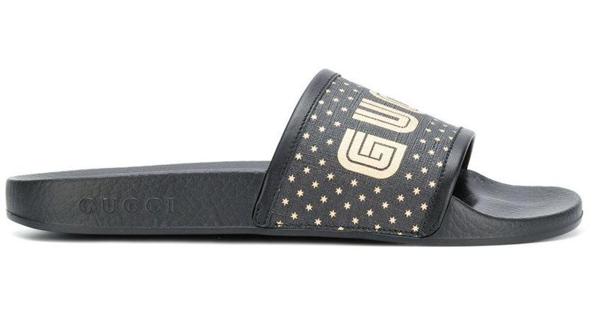 a7252a04034c Lyst - Gucci Pursuit Guccy Stars Sandals in Black