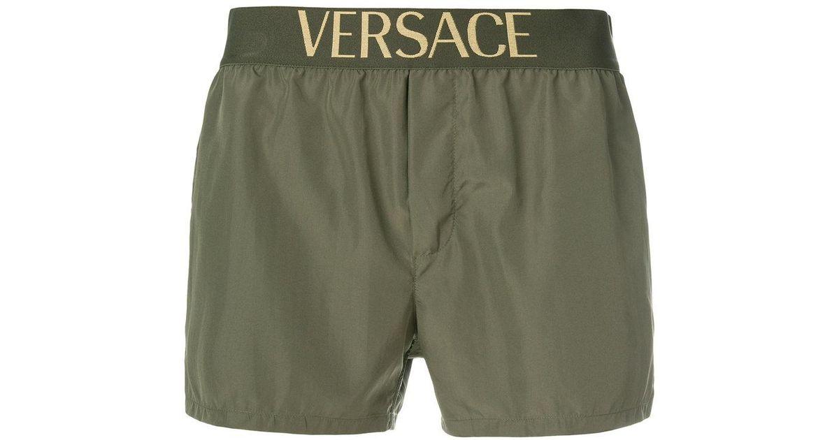 ff5e8a7e95 Versace Logo Waistband Swim Shorts in Green for Men - Lyst