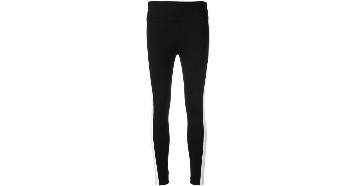 b0714e08a73f8 Lyst - Dkny Side Stripe leggings in Black