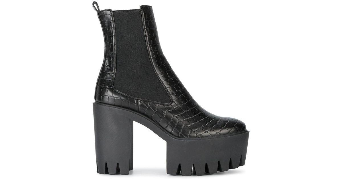 7cee52b4016c Lyst - Stella McCartney Monster Boots in Black