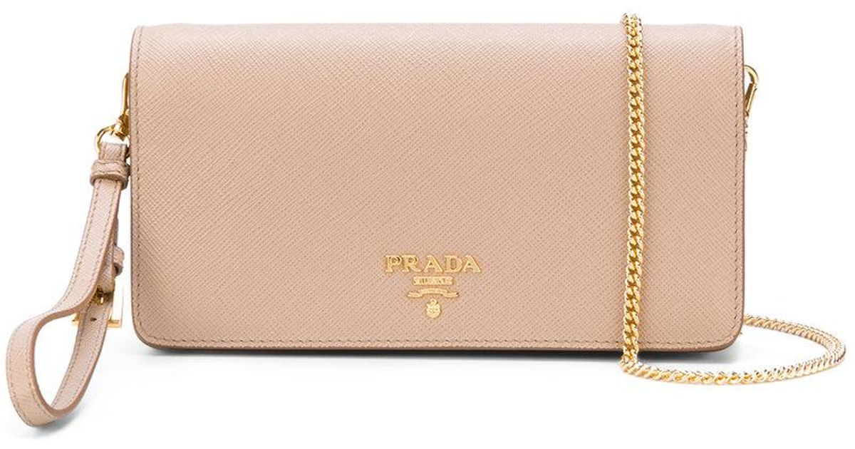 c7a39e8d1420 ... coupon code for prada saffiano wrist clutch bag in natural lyst 37709  d0155