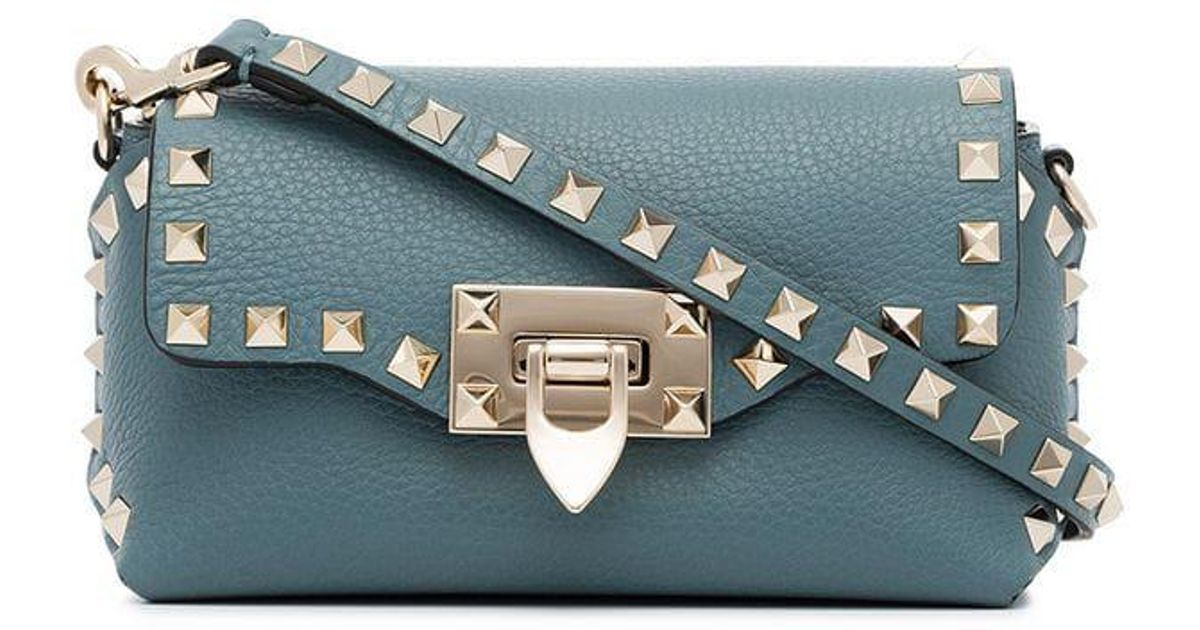 698e80b0a Lyst - Valentino Blue Rockstud Mini Leather Cross Body Bag in Blue