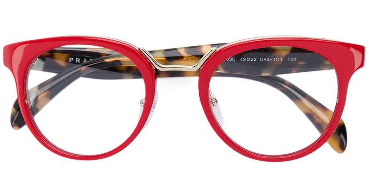 c4b42daba1bf ... discount code for prada round frame glasses in red lyst 51d23 721a4