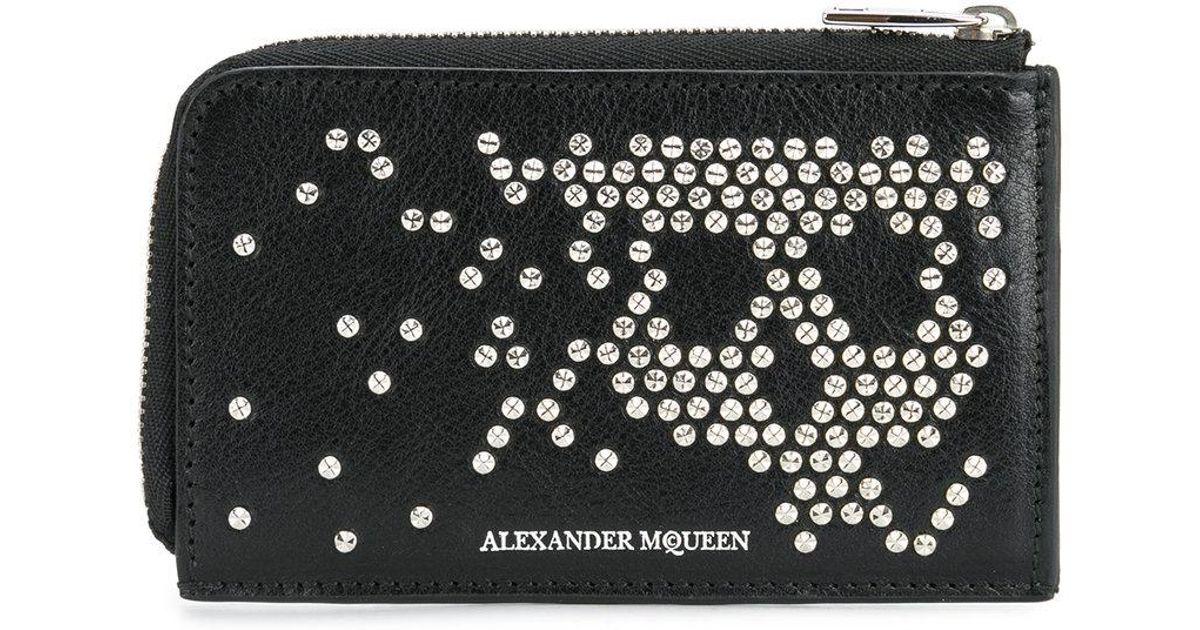 Lyst - Portefeuille à tête de mort cloutée Alexander McQueen pour homme en  coloris Noir 0ac3acf5b86