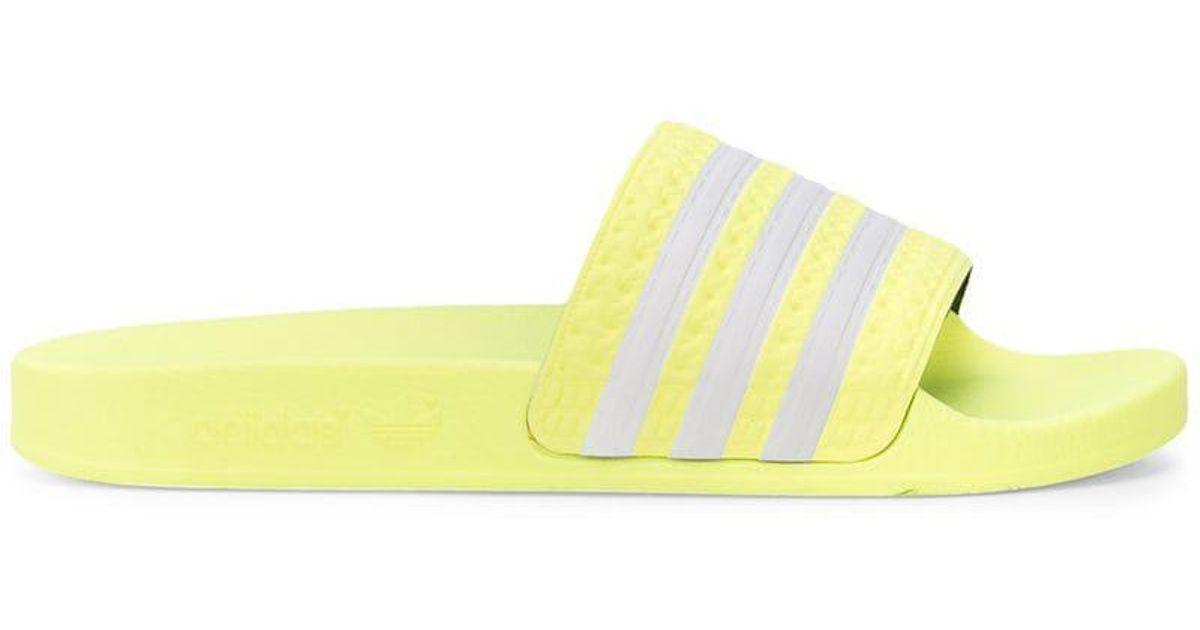 76f5de9494bd Lyst - adidas Originals Adilette Stripe Slides in Yellow for Men