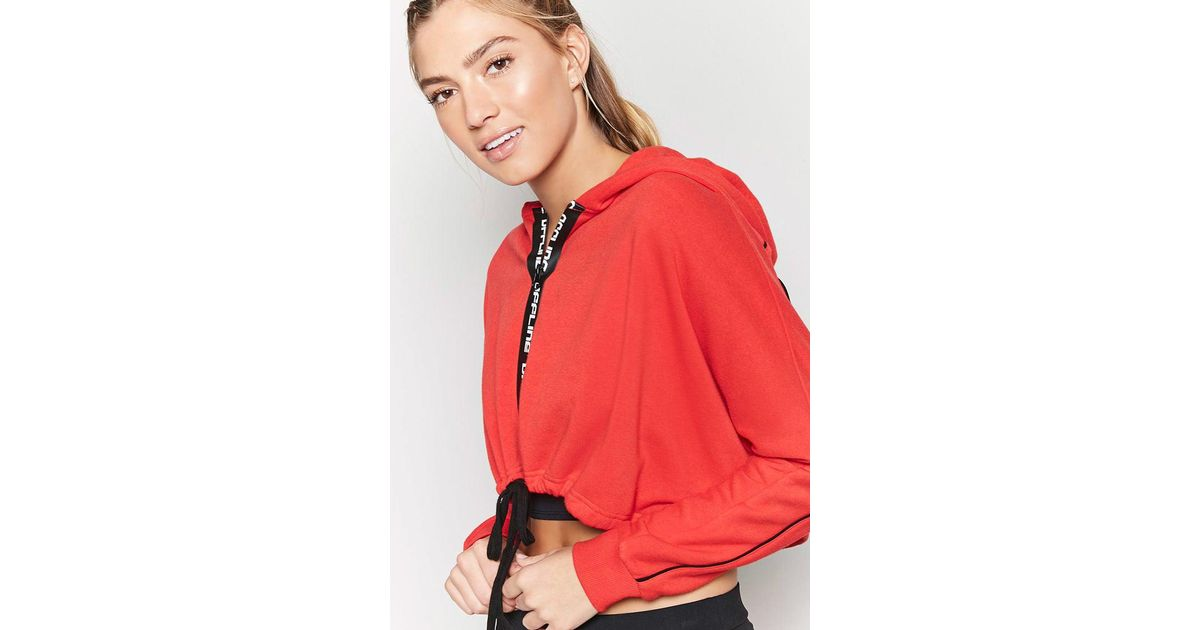 f78b968b677e1 Lyst - Forever 21 Active Offline Graphic Cropped Hoodie in Red