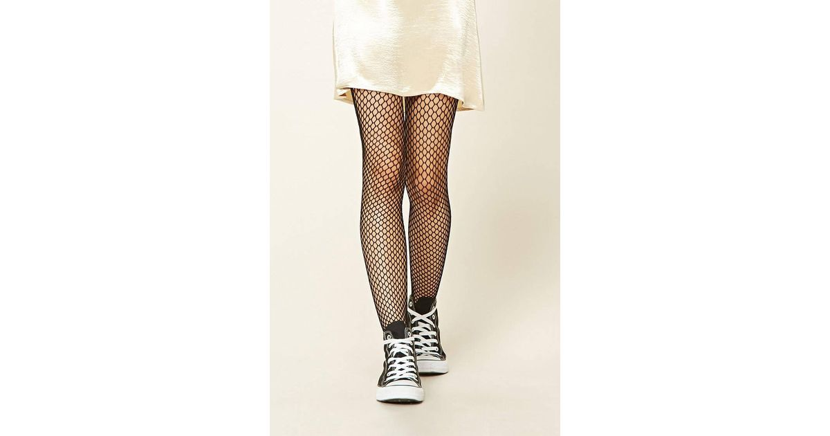 ba54c8243676d Lyst - Forever 21 Semi-sheer Fishnet Tights in Black