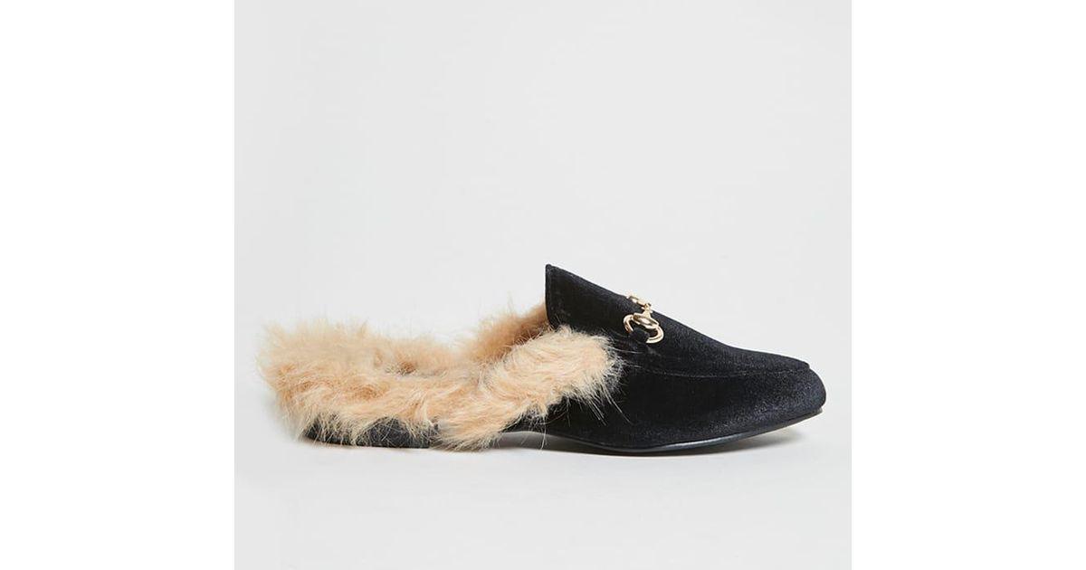 6165fa679c6 Lyst - Forever 21 Faux Fur Trim Loafer Slides in Black