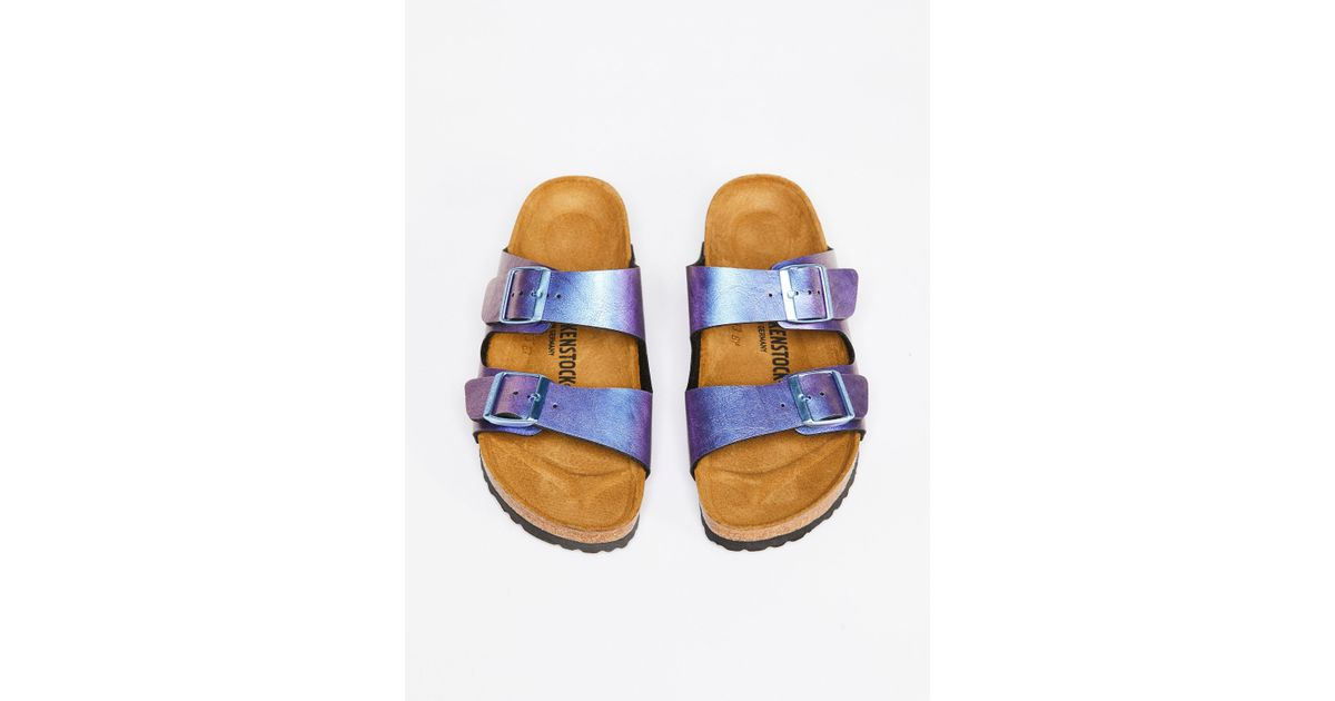 a884d72ce8127 Lyst - Free People Arizona Metallic Birkenstocks in Blue
