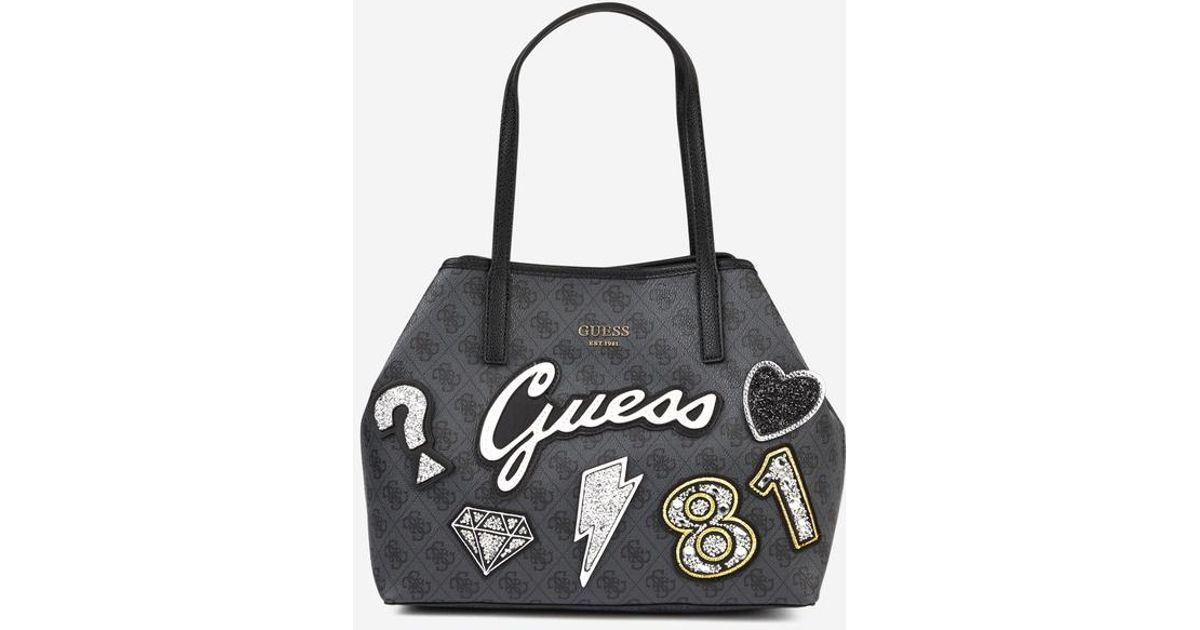 Sac cabas Vikky patches L Guess en coloris Black