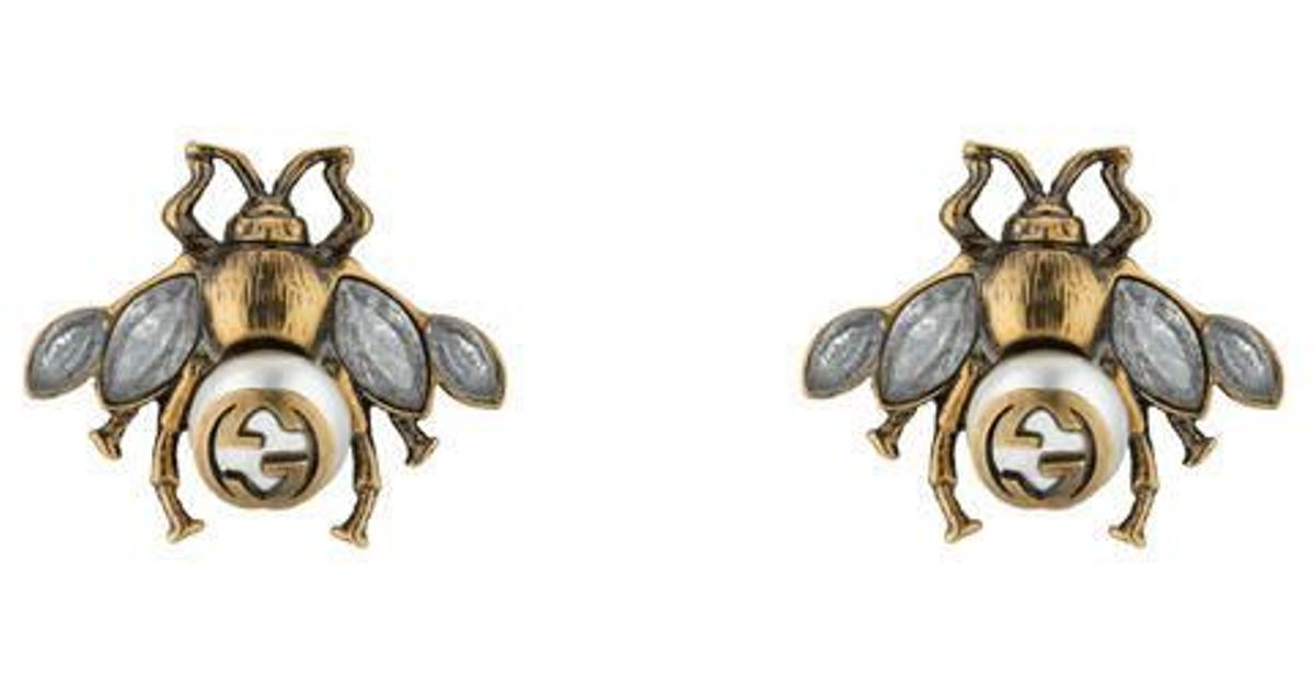 b1a3953b366 Lyst - Gucci Bee Earrings With Crystals in Metallic