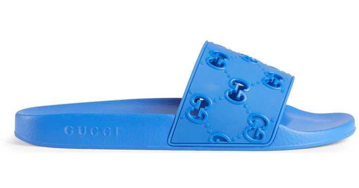 8ff2024af Gucci - Men's Rubber GG Slide Sandal in Blue for Men - Lyst