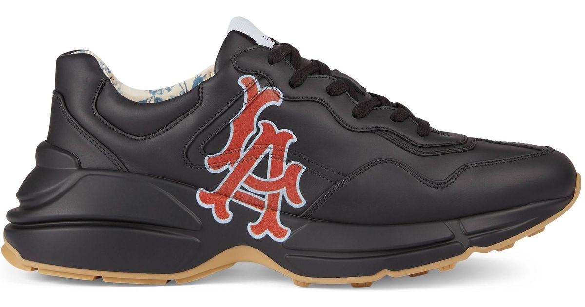 c8e01e32ffba Gucci Men s Rhyton Sneaker With La Angelstm Print in Black for Men - Save  35% - Lyst