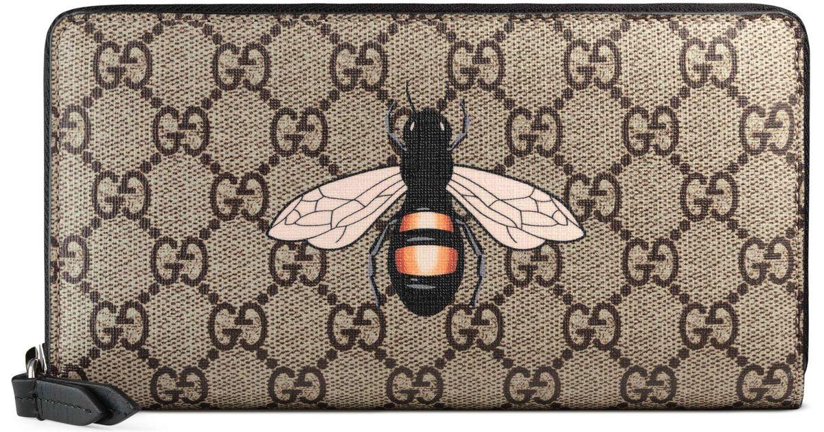 255365c7479 Lyst - Gucci Bee Print Gg Supreme Zip Around Wallet