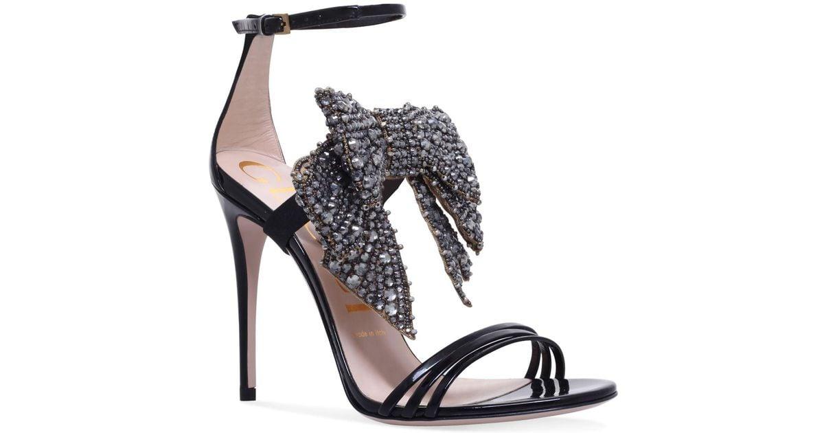 1058b49fb41 Lyst - Gucci Ilse Bow Sandals 110 in Black
