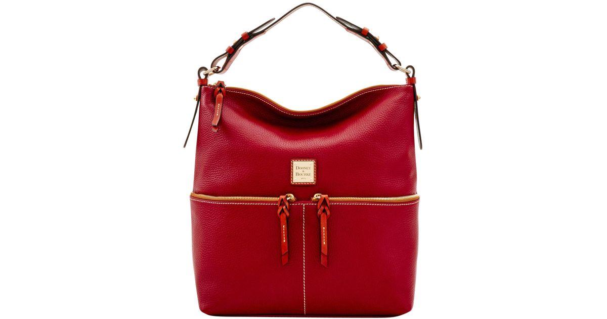 1a6ef06c3d Lyst - Dooney   Bourke Pebble Grain Zipper Pocket Sac in Red