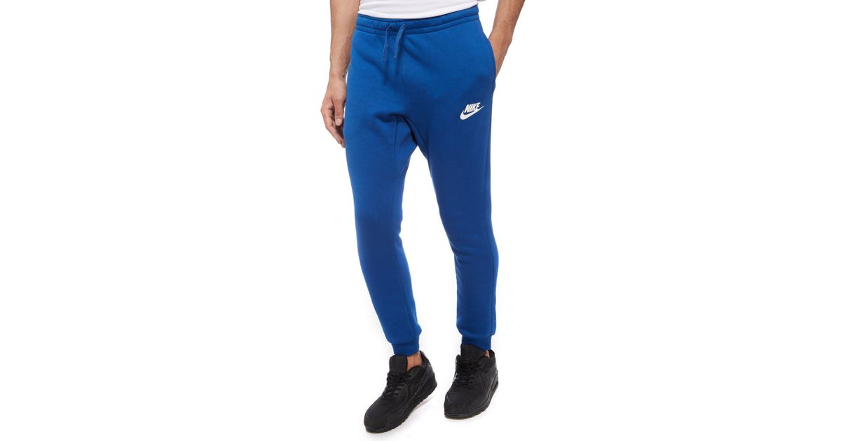 lyst nike just do it logo track pants in blue for men