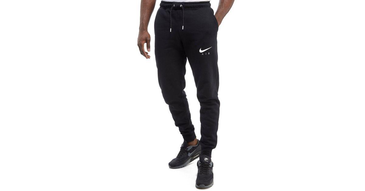 4bda9045f Nike Air Hybrid Jogging Pants in Black for Men - Lyst